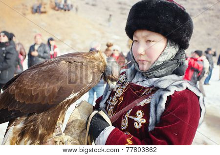 Nura, Kazakhstan - February 23: Eagle On Girl's Hand In Nura Near Almaty On February 23, 2013 In Nur