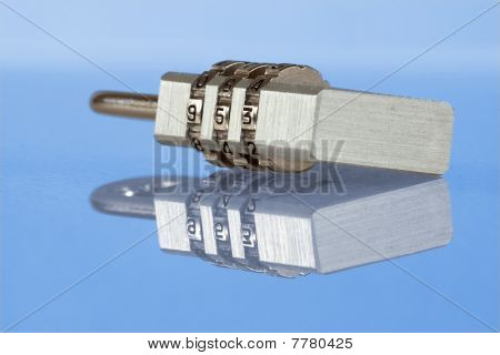 Numeric metal lock on blue background
