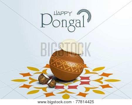 South Indian harvesting festival, Happy Pongal celebrations with rice in traditional mud pot and coconut on beautiful rangoli decorated blue background.