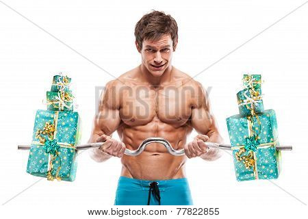 Muscular Bodybuilder Guy Doing Exercises With Gifts Over White Background