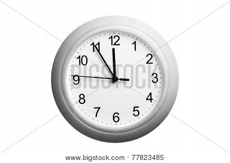 A Single Simple Clock Showing The Time Five To Twelve