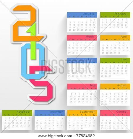 Stylish annual calendar with colorful text 2015 on grey background for Happy New Year celebrations.