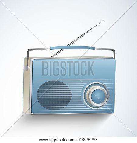 Retro transistor radio isolated on shiny sky blue background.