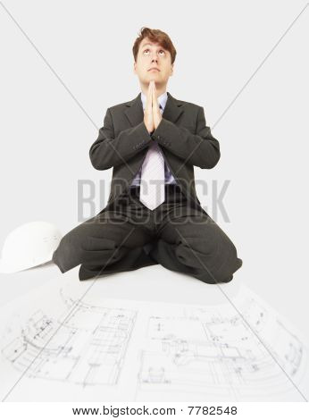 Builder Prays To God Sitting Near Drawing