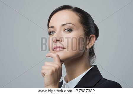 Confident Female Manager With Hand On Chin