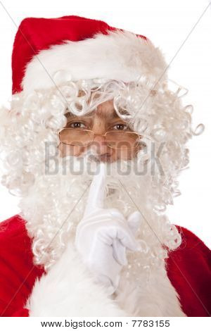 Closeup of Santa Claus holding his finger on lips to have silence.