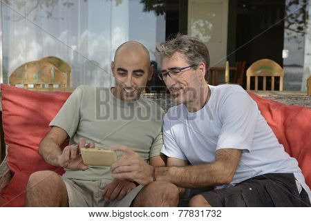Men looking at photo or website on mobile phone