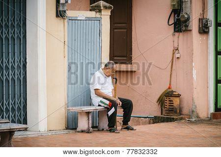 LUANG PRABANG LAOS - OCTOBER 26; Unidentified man sleeping on the street on October 26 2014 Luang Pr