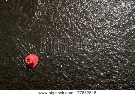 Red Buoy On The Water Surface