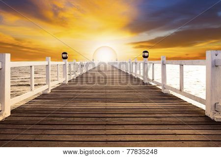 Sun Set Scene And Old Wood Bridge Pier With Nobody Against Beautiful Dusky Sky Use For Natural Backg