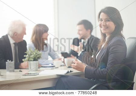 Businesswoman Pointing Her Co-workers