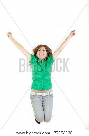 Girl Jumping  With Raised Arms Up Of Joy Excited Isolated On White Background In Green Shirt And Gra