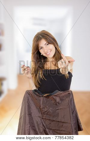 Smiling Female Hairdresser With Comb And Scissors Waiting
