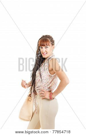 Woman With Extended Braids Hair In Tight Brown Pants And Shirt
