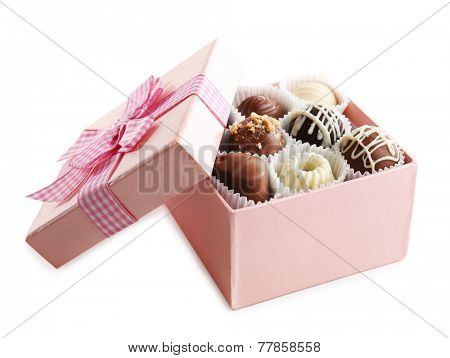 Delicious chocolate candies in gift box isolated on white
