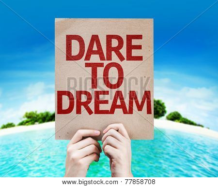 Dare To Dream card with a beach on background