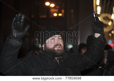 Protester with hands up gesture
