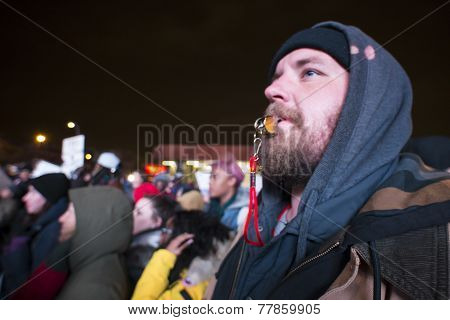 Bearded activist with whistle