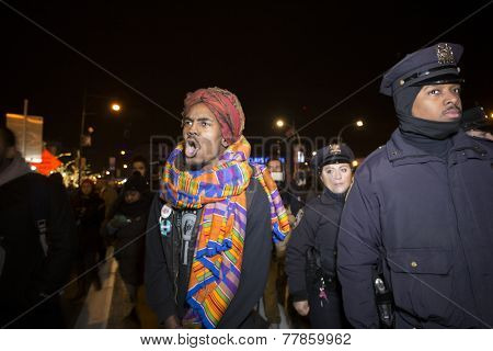 Activist marching alongside NYPD