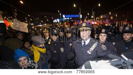 NYPD supervisors face off demonstrators