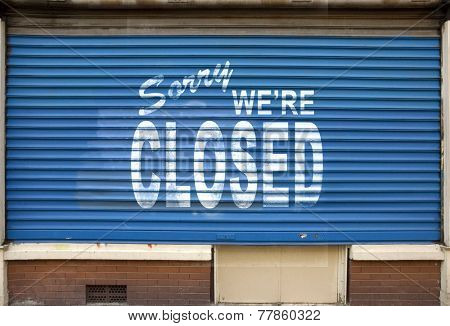 Shop with the blinds down and the sign, sorry we are closed
