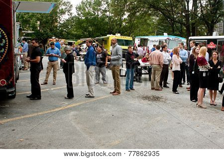 Customers Wait In Line To Order Meals From Food Trucks