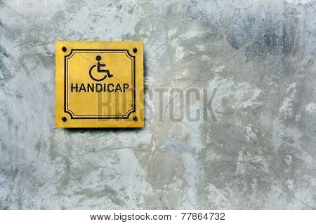 Handicap Symbol On Cement Background