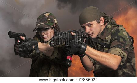 Portrait of soldiers up in arms