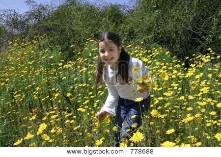 Girl Picking Up Flowers