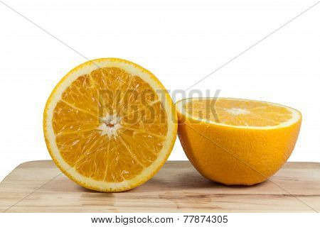 half of oranges on wooden