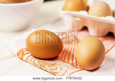Fresh brown eggs in carton