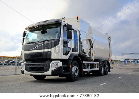 White Volvo FE Refuse Collector Truck