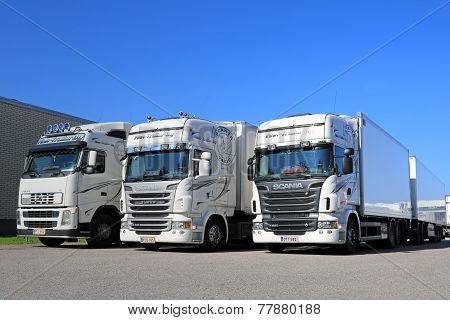 Fleet Of White Scania And Volvo Trucks On A Yard