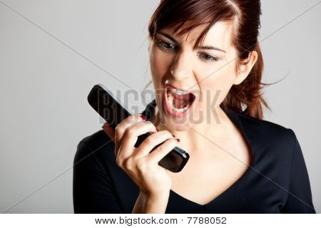 Unhappy Woman At Cellphone