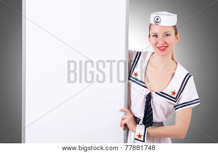 Stewardess with blank board on white
