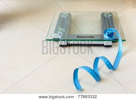 Weight scale and tape measure on bathroom