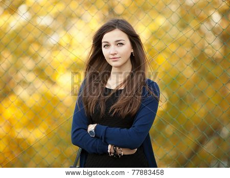 Outdoors portrait of a young beautiful brunette woman