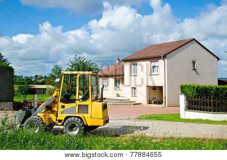 Tractor Near House