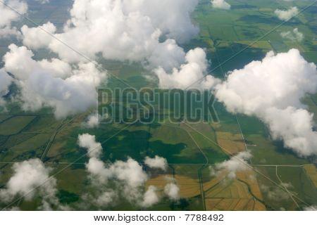 Aircraft bird view of green fields