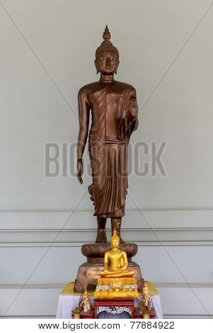 Walking Buddha Statue With Imparting Fearlessness Gesture In Thailand