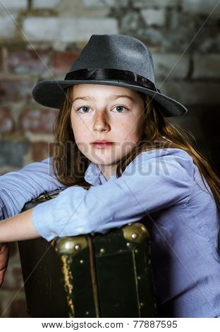 Cute Schoolgirl Portrait With Vintage Suitcase