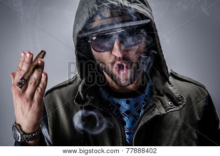 Handsome guy smoke a cigar