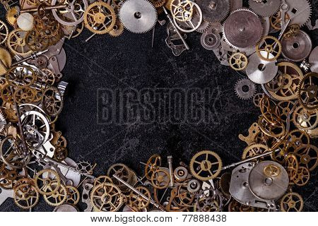 Details, technology. Heap of small gears on the table
