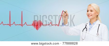 healthcare, medical and technology concept - young female doctor drawing heartbeat cardiogram in the air over blue background