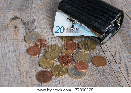 Little Black Coin Purse With Some Coins