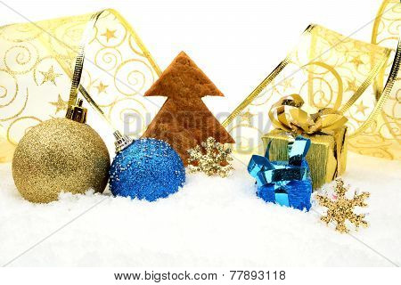 Golden And Blue Christmas Decoration On Snow With Cookie Tree