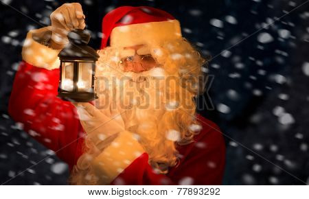 Santa Claus lurking in the night with a lantern