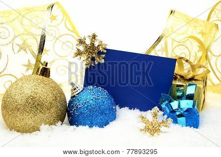 Golden And Blue Christmas Decoration On Snow With Wishes Card
