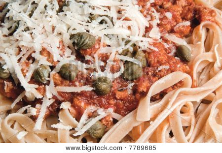 Pasta With Minced Meat, Capers And Parmesan Cheese