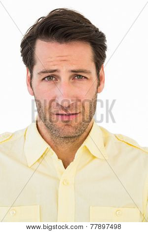 Handsome young man looking confused on white background